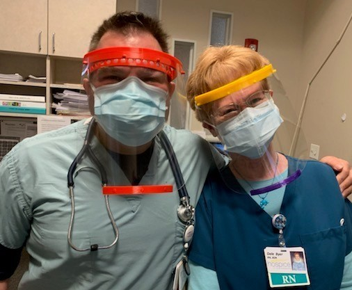 Chief Medical Officer Dr Eric Bush and Dale Byer, RN, don personal protective equipment while working in the Rebecca Fortney Inpatient Care Center on the John & Cathy Belcher Campus of Hospice of the Chesapeake in Pasadena, Maryland.