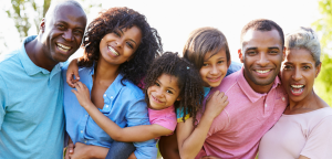 African American family including grandparents, parents and children smiling and together
