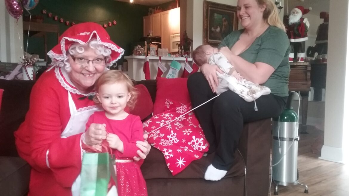 Hospice of the Chesapeake Volunteer Alice Jo Weaver dressed as Mrs. Santa to deliver gifts to a pediatric hospice family