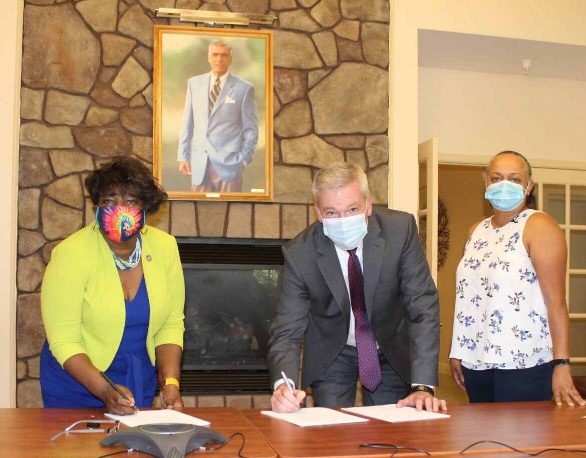 Signing the papers that make Hospice of the Chesapeake's acquisition of Hospice of Charles County final are, from left, Delegate Edith Patterson, Hospice of Charles County Board of Directors Vice Chair; Mike Brady, Acting CEO, Hospice of the Chesapeake; and Regina Moody, Chief Operating Officer, Hospice of the Chesapeake.
