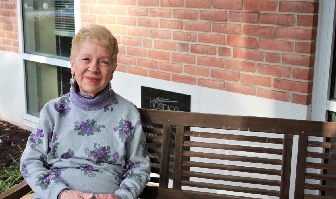 Gloria Kinsley poses outside of the Hospice of the Chesapeake offices in Pasadena, Maryland, in 2019. She is one of the organizations companionship caller volunteers