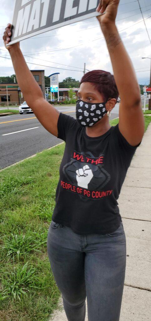 Nurse Practitioner Rachel Sherman protesting against racism at Fish Market restaurant in Clinton, MD