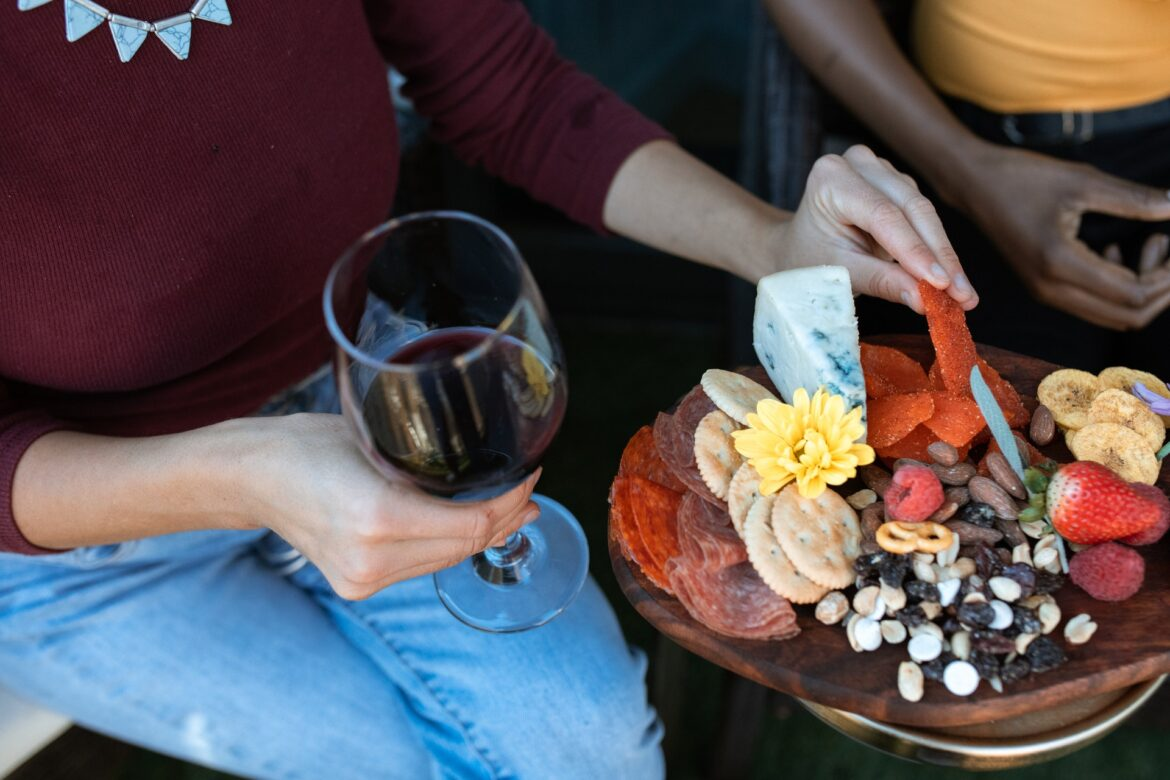 Wine tasting photo with charcuterie board