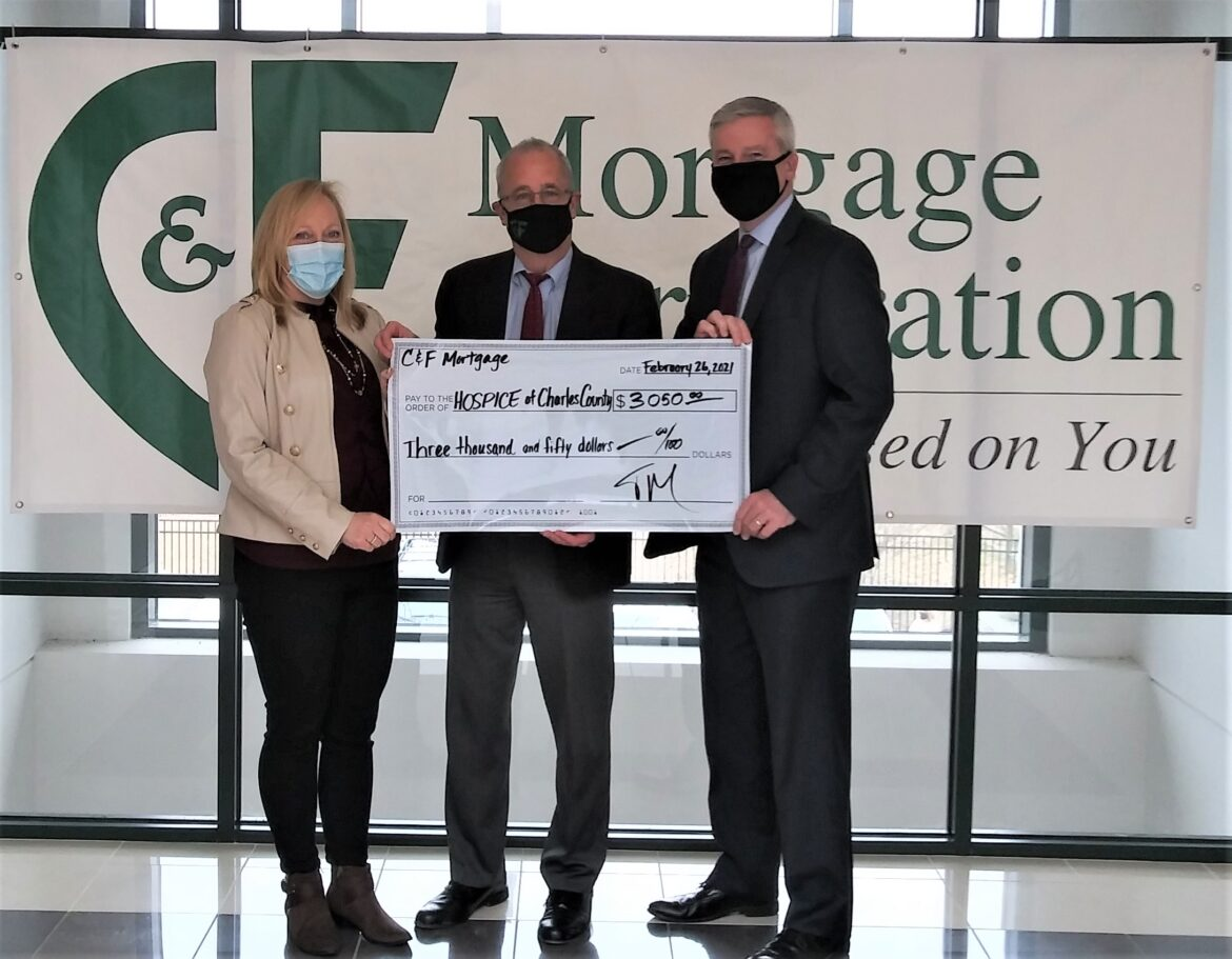 C & F Mortgage Corporation Waldorf Branch Manager Tim Murphy, center, presents a check for $3,050 to Hospice of Charles County, a Hospice of the Chesapeake affiliate. The nonprofit's Director of Advancement and Volunteer Services Chris Wilson, left, and President and CEO Mike Brady, right, accept the donation with gratitude.