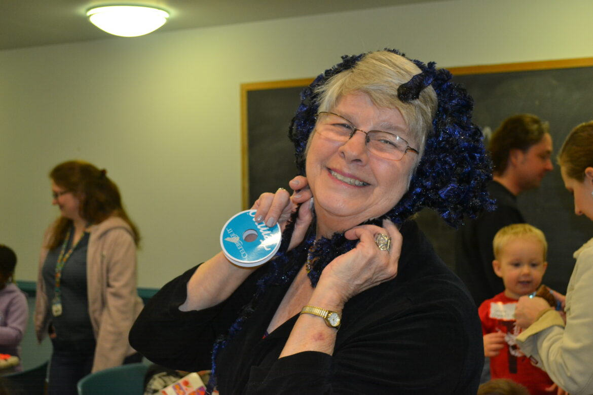 Carol Fritz has some fun while she volunteers at a Chesapeake Life Center event