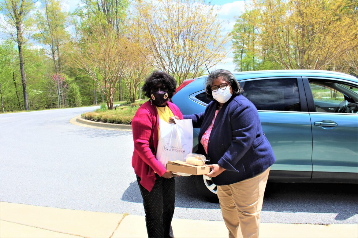 From left, Delegate Edith Patterson, Hospice of the Chesapeake Board member, receives her wine and charcuterie kit from Hospice of Charles County Donor Relations Manager Gwen Russell at the organization's offices in Waldorf.