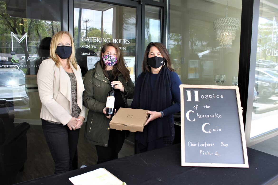 From left, Hospice of the Chesapeake's Director of Advancement and Volunteer Services Chris Wilson and Event Coordinator Meg Lawton stand with Main & Market's Vice President Evie Turner in Annapolis ready to give the Italian wine and charcuterie to participants of the virtual Tuscan Twilight Tasting fundraiser.