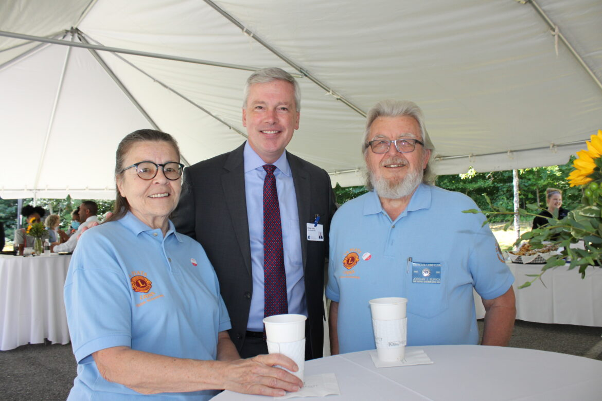 Connie and Jordan Burick of the LaPlata Lions Club flank Hospice of the Chesapeake President and CEO Mike Brady at the Hospice of Charles County Ribbon Cutting on June 23, 2021.