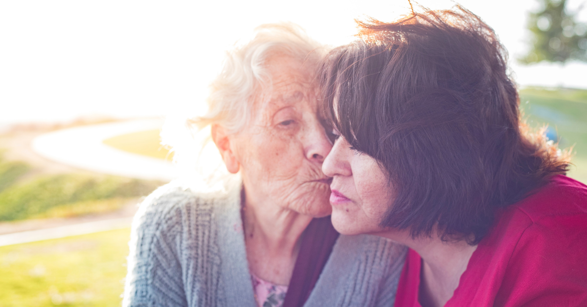 Caregivers support group photo shows elderly woman with another woman