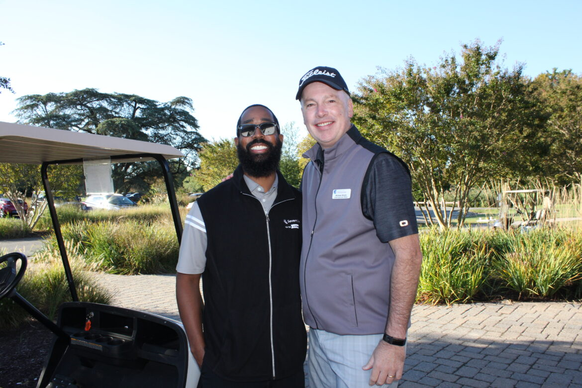 Jerray Slocum of Severn Bank and Hospice of the Chesapeake President and CEO Mike Brady pose before the start of the Golf Tournament