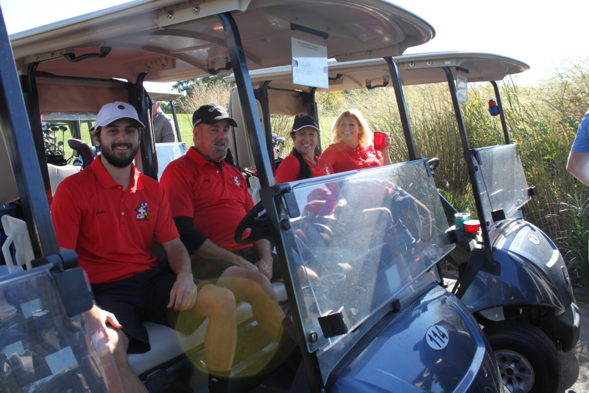 The team from Permits Plus, Inc., is ready to roll before the shotgun start of the Golf Tournament